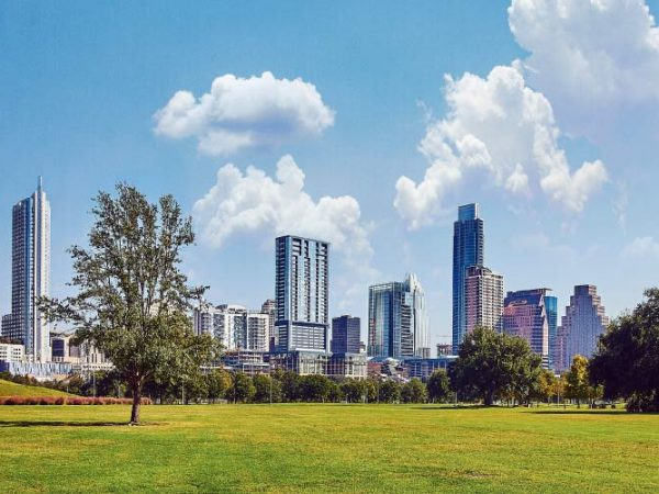 View of Austin skyline during the hot summer from Zilker park