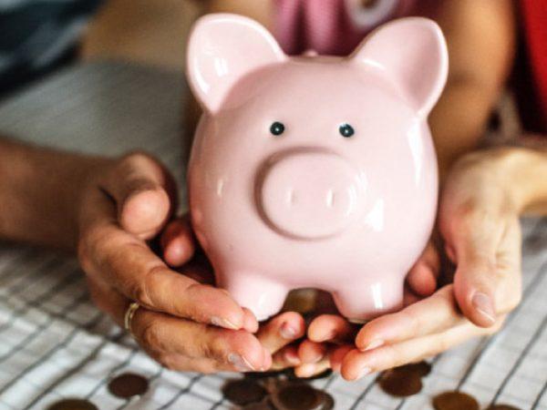 Pink piggy bank full of coins